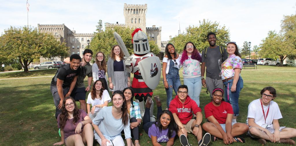 Manhattanville students with the Valiant mascot.